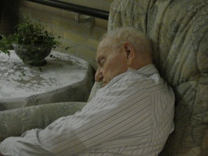 old man sleeping on couch